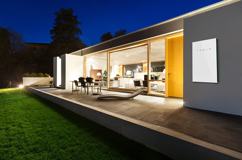 Tesla Powerwall powering a home at night